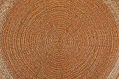 Golden beadwork texture background with round lines pattern