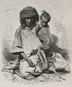 Antique illustration of undernourished mother and son in Algeria. Created by Janet-Lange and Dutheil