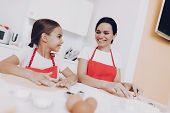Mom And Girl Cook Together. Beautiful Mom And Young Girl. Dessert For Girl And Mom. Bake A Cake. Bak poster