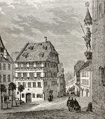 Old illustration of Albrecht Durer house and Martin Koetzel statue in Nuremberg, Germany. Created by Th?rond and Terington, published on Le Tour du Monde, Paris, 1864