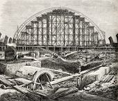 Old illustration of Midland railway station (St. Pancras) construction in London. Created by Loudon,