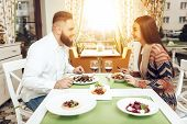 Romantic Dinner Happy Men And Women In Restaurant. Happy Couple Enjoying A Romantic Dinner In Two. A poster
