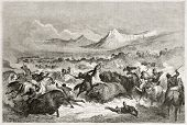 Old illustration of native Americans hunting buffalo. Created by Dore after Caitlin, published on Le
