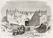 Old engraved illustration of Damascus gate, Jerusalem. Created by Therond and Maurand after photo of unknown author, published on Le Tour du Monde, Paris, 1860