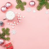 Christmas Background With Fir Branches, Lights, Red Giftboxes, Pink Decorations, Hot Drink With Mars poster