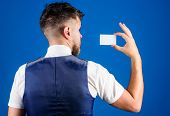 Man Hold Plastic Blank Card Blue Background Rear View. Take This Card. Banking And Credit Concept. P poster