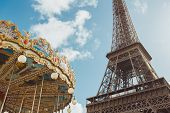 Eiffel Tower And Carousel Againstblue Sky, Eiffel Tower Is One Of The Most Iconic Landmarks Of Franc poster