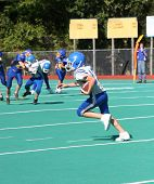 Teen Youth Football Player Running With The Ball