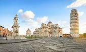 Pisa, Italy. Panoramic Low Angle View Of Piazza Del Duomo Square With Leaning Tower, Pisa Cathedral  poster