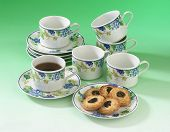 Hi-tea set with biscuits on a plate and a cup of coffee.