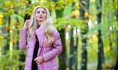 Girl Fashionable Blonde Walk In Autumn Park. Autumn Hair Care Concept. Autumn Hair Care Is Important poster