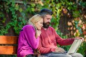 Couple With Laptop Sit Bench In Park Nature Background. Surfing Internet Together. Family Surfing In poster