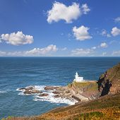The Lighthouse At Hartland Point, On The North Coast Of Devon, England, In Autumn. Lundy Island, In  poster