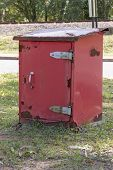 A Close Up Side View Of A Red Old Rusted Post Offcie Post Box Storage Unit poster