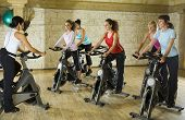 pic of exercise bike  - The group of women training on exercise bike at the gym with instructor - JPG