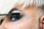 Focus On His Eyes. Male Makeup Look. Transgender Man Apply Mascara. Fashion Male Eye Makeup. Transge poster