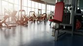 Blurred Empty Gym. Panoramic Picture - Modern Gym Interior With Equipment. poster