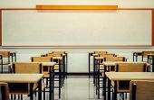 Back To School Concept. School Empty Classroom, Lecture Room With Desks And Chairs Iron Wood For Stu poster