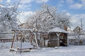 Morning Winter In A Country Yard, A Beautiful Winter Morning In The Resort, A Yard With A Swing And  poster