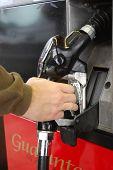 Hand On Gas Pump
