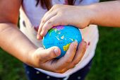 Earth Globe In Children Hands. Little Girl Holding Symbol World Map. Environment Conservation, Save  poster