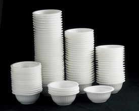 picture of non-biodegradable  - Styrofoam bowls stacked together on black background - JPG