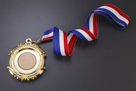 stock photo of gold medal  - Gold medal isolated on the background - JPG