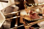 stock photo of trombone  - trombones playing live in a big band  - JPG