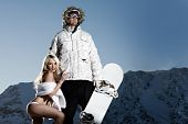 pic of groupies  - Macho snowboarder with adoring lingerie clad female fan - JPG