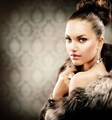 Beautiful Woman in Luxury Fur Coat. Sepia Toned.Vintage Style