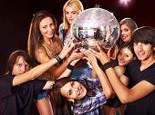 Woman on disco in night club. Disco ball.