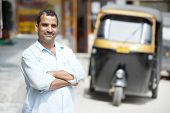 Indian auto rickshaw three-weeler tuk-tuk taxi driver man