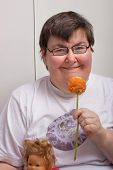 Mentally Disabled Woman With Flower