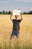 Farmer Guy In Wheatfield Holding Blank Sign