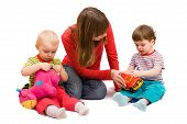 picture of babysitter  - Little girl and boy playing together with mother - JPG