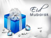 Muslim community festival background with gift box wrapped in ribbon on abstract grey background.