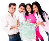 Family recycling plastic bottles - isolated over white