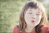 Little Girl Giving An Air Kiss