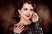 Young Happy Woman Talking On Mobile Phone. Fashion Brunette Model Portrait. Red Lips.