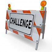 Challenge word on a construction barricade or barrier blocking your path which you must overcome and rise above to achieve a goal, mission or success in life