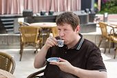 Young Man Drinking Traditional Turkish Mocca Coffee