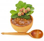 cloudberry jam bowl and spoon with fresh berry  close up isolated on white background