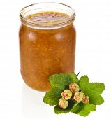 cloudberry jam jar with fresh berry close up isolated on white background