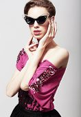 High Fashion. Glamorous Elegant Woman In Dark Sunglasses. Magnetism
