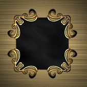 black plaque with gold patterns on a background of gold