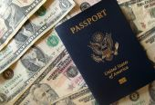 American Passport on a stack of cash