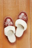 Home Slippers On The Wooden Floor