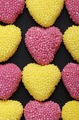 group of heart shaped jelly beans and pink and yellow