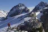mountaineer  against Foratata peak in Tena Valley, Huesca, Pyrenees, Aragon, Spain