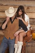 Cowboy And Indian Woman Sit Saddle Face Hidden